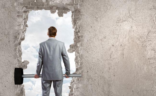 man breaking through wall