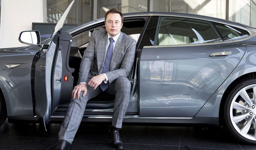 Elon Musk sitting in a car