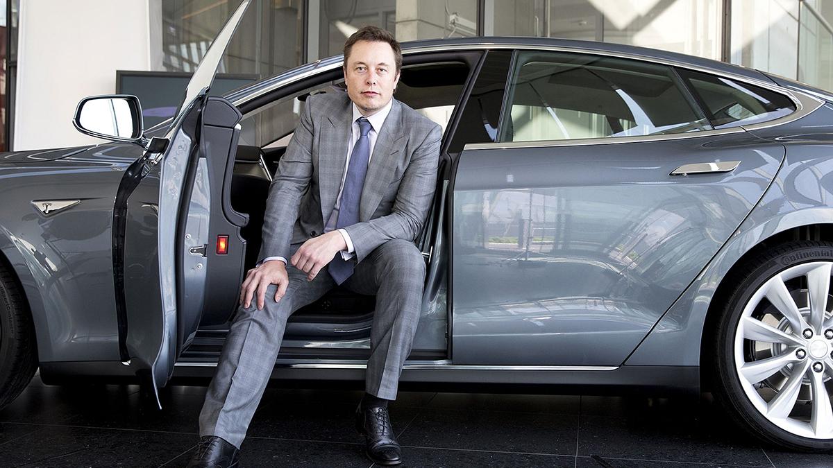Elon Musk sitting in a car